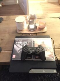 PS3 with 2 games and controller