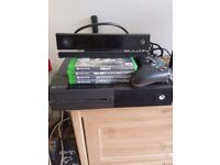 Xbox one, with kinect, 2 headsets, and 4 games.