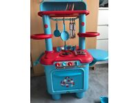 Early Learning Centre Plastic play kitchen and food set.