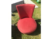 Small upholstered red chair