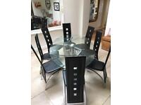 Glass extending dining table and 6 chairs