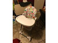 High chair with removable trays inclines
