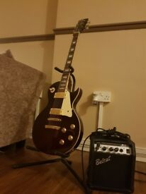 Electric guitar (vintage brand) + amplifier and cables