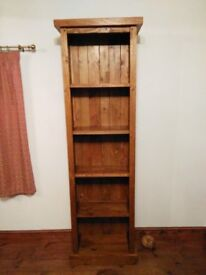 Tall slim pine bookcase.