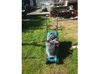 Lawn mower in excellent condition for sale.