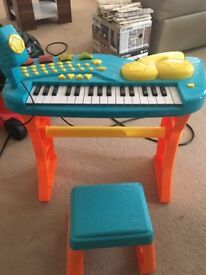 Kids piano with microphone and chair
