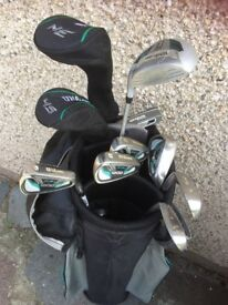 Lady's Wilson golf clubs including cart bag nearly new