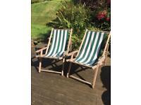 Two wooden deckchairs