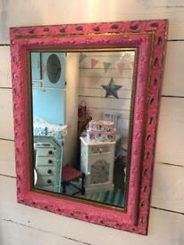 Pink and gold ornate mirror