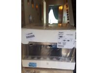 BRAND NEW built in whirlpool microwave 6th sense technology