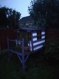 Wooden Wendy house On Stilts With Steps And Slide. Collection only.