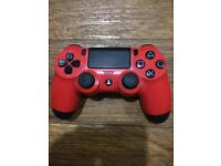 Red playStation 4 wireless controller
