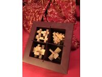 Set of 4 wood puzzles