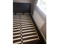 Large black slatted double sleigh bed