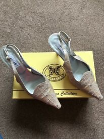 Beige occasion shoes and matching clutch bag