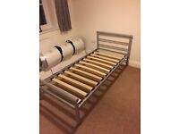 Metal frame single bed.