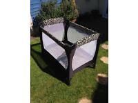 Travel cot in black for baby toddler
