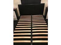 Otto garrison ottoman storage double bed black