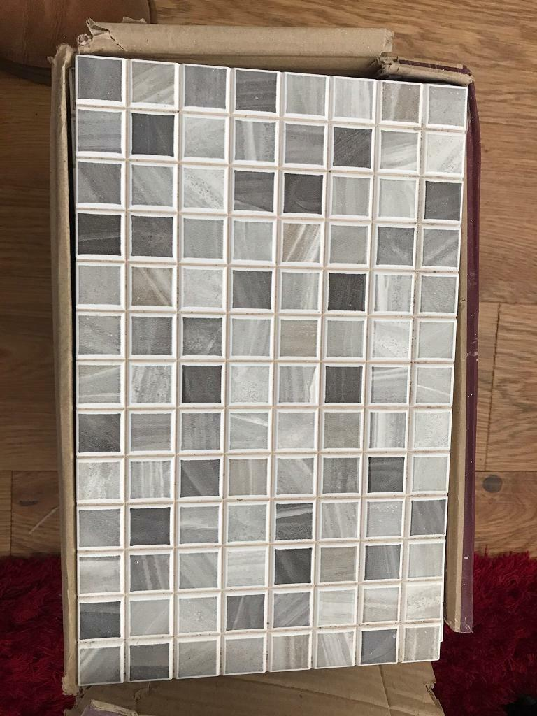 Sold - One box of mixed grey checkered patterned porcelanosa tiles.