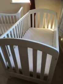 Lovely solid white cot bed from mamas and papas.
