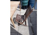 Patio wooden folding chairs.