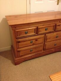 A set of chest of drawers and bed