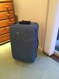 Large blue suit case by Foire with wheels 29x16x11inch