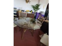 Unusual Glass Dining table and 4 chairs