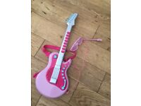 Toy guitar with sounds, glasses and mic. Used but good condition, collection
