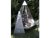 Growmate revolving octagonal pyramid greenhouse.