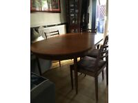 Teak Gplantable and chairs. Good condition .to good to chop up