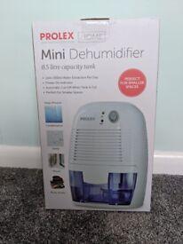 PROLEX Mini Dehumidifier New in Box - Dries Clothes, Prevents Damp