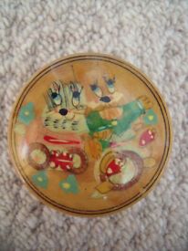 Cute round wooden trinket box -illustration of kitsch colourful rabbit & cat (?) riding bike on lid