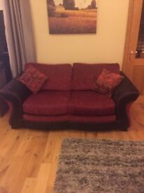 3 and 2 seater sofas with storage pouffe in excellent condition.