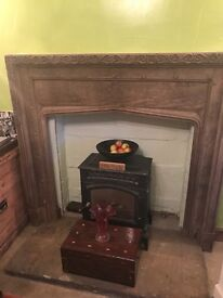 Wooden surround fireplace with engraving