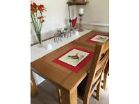 Solid oak dining table with 2 chairs.
