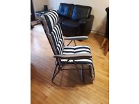 Confortable set of 2 new deckchairs with fireproof upholstered cushions.