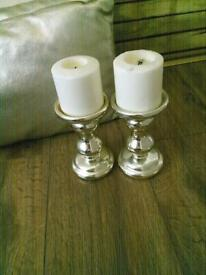 Two leather cousins with two candles and candle holders