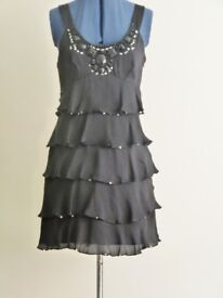 Dress, cocktail style by Warehouse in black. Size 14