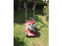 Suffolk punch rotary push mower in good working order.