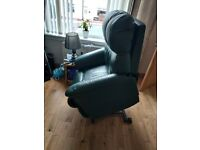 Green leather rise and recline arm chair