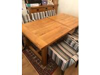 Solid oak extendable dining table with Ikea Nils chairs x 6