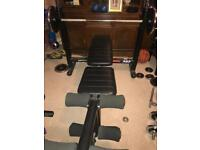 Bench press with barbell, plates and weight stand