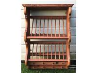 Antique pine plate and mug rack with inset old penny