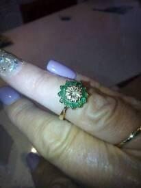 9CT EMERALD AND DIAMOND RING £45
