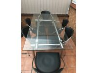 For sale. Glass top dining table and six chairs