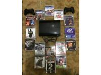Sony ps3 with 15 games 2 controllers