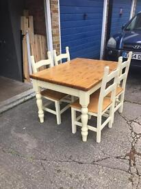 Farmhouse dining room table with four solid oak chairs /cream colours