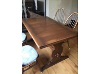 Ercol Golden Dawn Dining table + chairs - seats 6-8 people. Excellent Condition