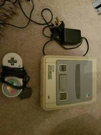 Snes and pad with all leads ,super Nintendo